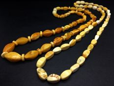2 Natural old Baltic Amber necklaces of old yellow beeswax and white marble colour beads, 21.9 grams