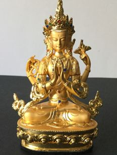Depiction of Chenrezig in gold-patinated alloy Nepal early 21st century