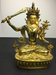 Depiction of Manjushri in copper with gold patina - Nepal - Early 21st century