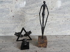 2 bronze plated sculptures on matching marble pedestals, by Dutch artists