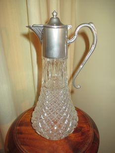 Beautiful Cut Glass Claret Jug with silver plated pieces.