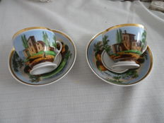 2 Porcelain cups and saucers with landscape decor