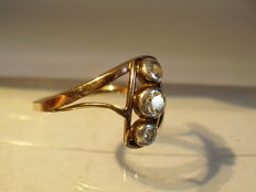 Antique 14 kt gold ring with 3 diamonds of in total 0.18 ct in white gold frames