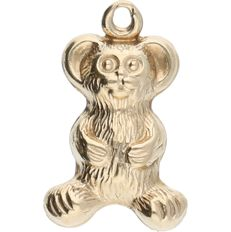 14 kt yellow gold pendant in the shape of a monkey.