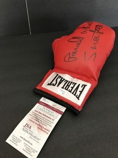 Right handed Everlast boxing glove is hand signed with Pernell Sweet Pea Whitaker,James Spence Authentication