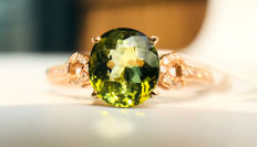 18kt gold ring with Green Tourmaline 1.35ct. and diamonds 0.13ct. Size 7/14/54/17.2mm