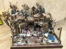 Handcrafted nativity scene with lights
