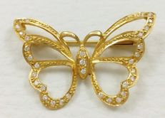 Pendant/brooch with 18 kt yellow gold butterfly with zircons