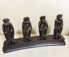 Unknown producer - bowed woodpanel with 4 monkeys