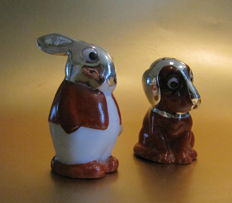Porcelain salt and pepper set with 1000/1000 silver, dog and hare
