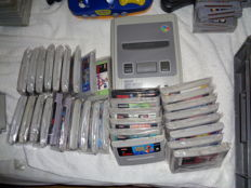 Big lot of Super Nintendo with 33 games and converter.