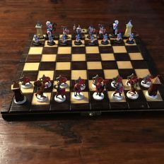 Hand-painted tin knight chess set in wooden folding box