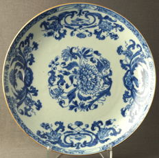 Deep plate with design of blossom branches, fish and birds - China - 18th century