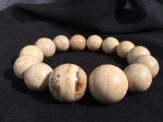Natural royal white/ beige untreated Amber graduated bracelet, 31.7 grams weight, no reserve