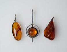 3 vintage pendants with amber in silver, carving, 13.04 g