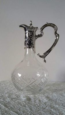 Crystal wine decanter decorated with a beautiful silver-plated frame