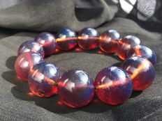 Deep Blue translucent untreaed Amber  beaded bracelet, fluorescent colours, 52.3 grams weight