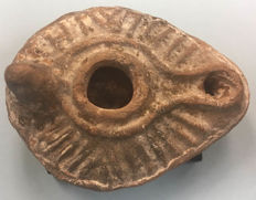 Ancient byzantine pottery decorated oil lamp - 600-800 AD--.85 long x 65 wide x 40 high mm