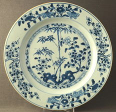 Large double plate with decoration of bamboo and blossom branches on a rock formation - China - 18th century