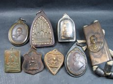 A collection of 8 Buddhist amulets to include a Tukrut - Thailand - 1964 and later.