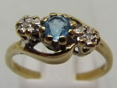 9 kt gold ring with blue Topaz and 2 Diamonds