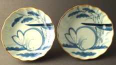 2 large deep dishes with decoration of a hare in a grassy landscape - Japan - late 19th century