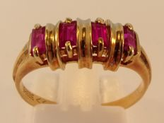 Vintage 14 kt yellow gold ring with 4 baguette cut rubies