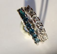 Antique ring or engagement ring: 2 separate rings connected with each set with 7 blue and 7 white natural Sapphires 1.12Ct. total in river setting.