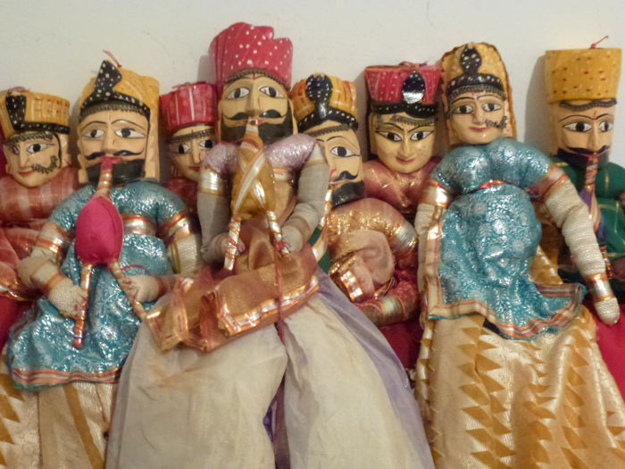 Eight puppets of the Thai culture - each is different from the other - made of wood and with embroidered silk dresses - with bright colours of the tradition