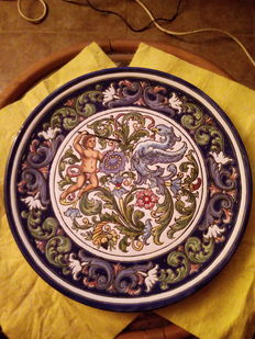 Set of 5 hand-painted ceramic plates.