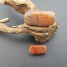 Red agate bead.  26.2 x 9.2 mm.  10.6 g