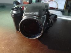 OLYMPUS with a leather case and an Olympus Ni-MH battery charger