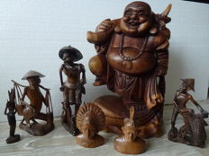 Collection of 7 wood carving various sizes, characters and countries, including - smiling Buddha, fisherman - Balinese - Indonesia & China