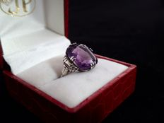 Art Deco silver ring set with a large sparkling faceted Amethyst