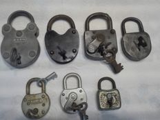 7 old padlocks with their keys