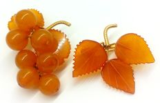 Two vintage gold plated brooches of Baltic Amber, a bunch of grapes and a leaf brooch