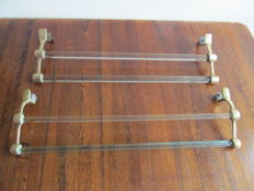 A set of double Art Deco brass towel racks and glass