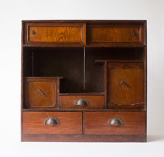 A classic cha-dansu (tea cabinet). Simple design and with various drawers and sliding doors – Japan – early 20th century