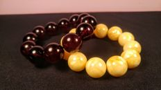 Set of 2 vintage Baltic Amber round modified beads bracelets in egg yolk and cherry colour, 82 grams