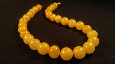 Vintage modified round beads Baltic Amber egg yolk colour necklace, length ca. 48 cm, 66 grams