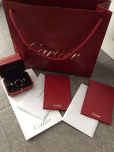 Cartier Trinity set, earrings and ring, 18 kt