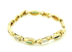 14 kt - yellow gold - bracelet - with ruby, emerald and sapphire trim, per element 0.15 ct. - 35 brilliant cut diamonds of 0.01 ct. ***no reserve***