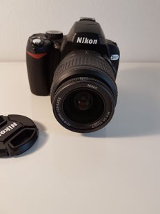 Nikon D60 + 18-55 mm DX (with charger)