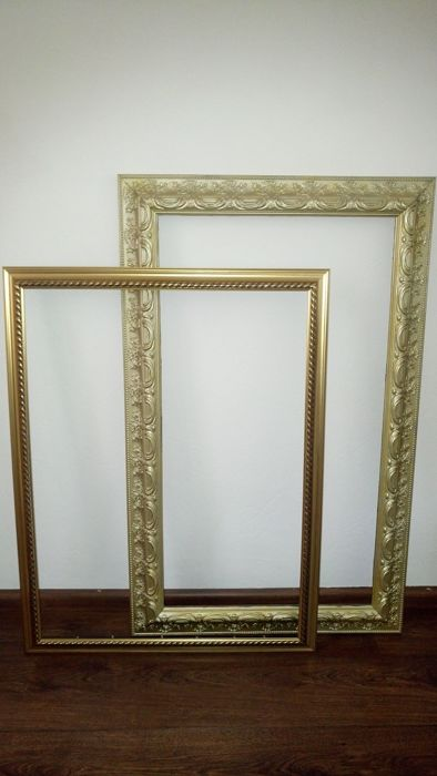 Two very large gold-plated frames - Catawiki