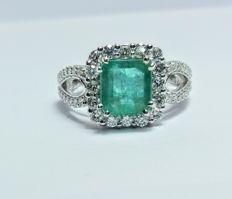 A 3ct Emerald and Diamond ring.