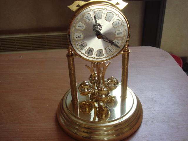 Clock under globe Haller Germany quartz