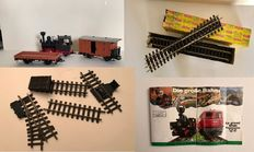 Scale G - LGB - 4010/4030 - 1 Steam locomotive, 2 freight carriages, rails, buffer blocks, switch, and transformer