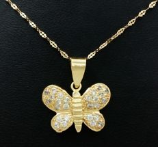 Choker and butterfly in 18 kt yellow gold.