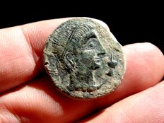 Roman Hispania - Castulo (Linares, Jaén), bronze as (12,00 g. 25 mm.) minted around 180 - 150 B.C. CASTELE. Hand series. Sphinx.