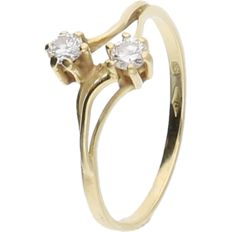 18 kt - Yellow gold wavy ring set with 2 brilliant cut diamonds, approx. 0.16 ct in total - ring size: 15.75 mm